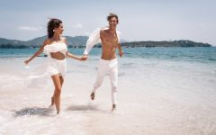 young-beautiful-man-woman-couple-white-clothes-running-along-beach_120960-23