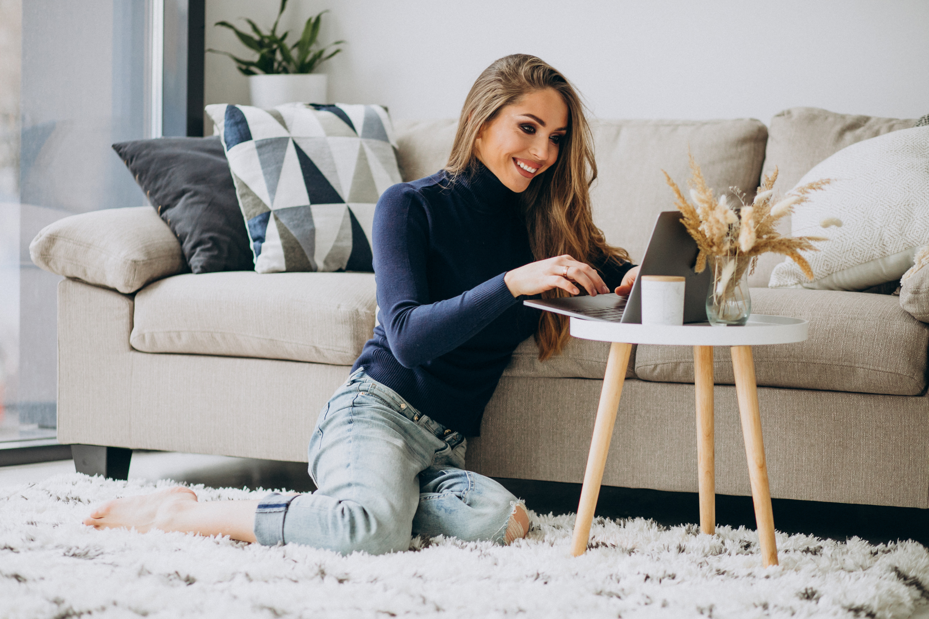 Business woman working on laptop at home