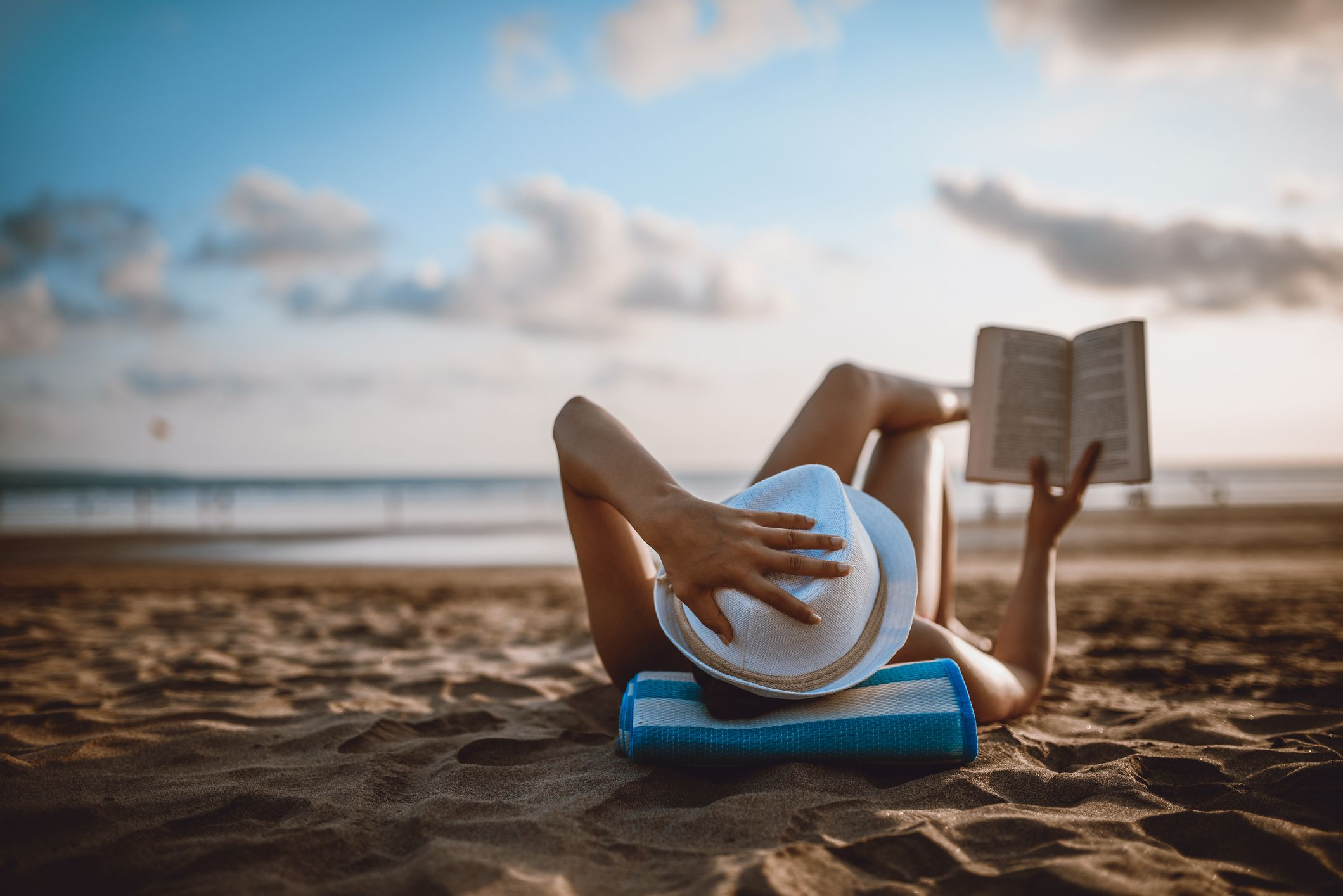 woman-reading-on-beach-5c1ed74646e0fb0001d0254b